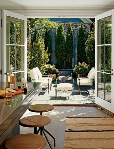 lovely space off kitchen + French doors. yes please. Architectural Digest