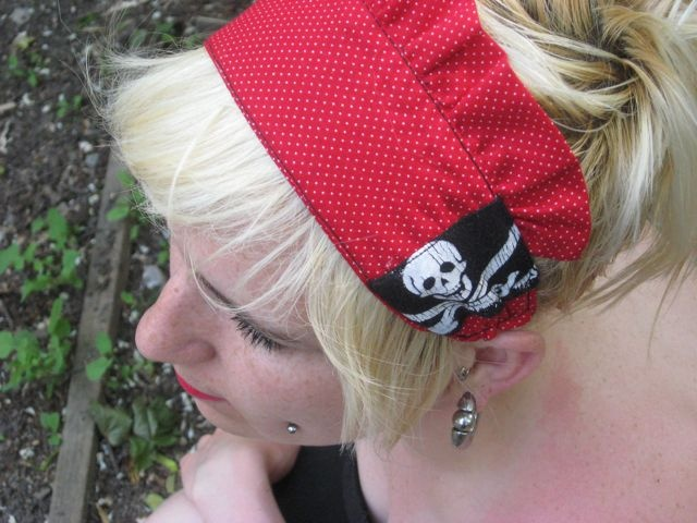 Red skull and cross-swords domestic headband by morgan cleopatra