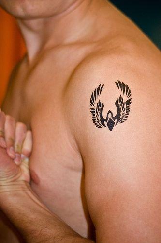 Minimalist phoenix tattoo. I like this a lot