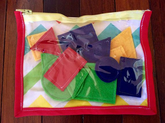 This set of 16 colourful shapes includes 4 squares, 4 rectangles, 4 circles and 4 triangles made of blue, yellow, red and green felt. Shapes are of two different sizes - large and small. Carry the shapes with you in the compact carry case. With a clear PVC vinyl front and colourful cotton zigzag backing, zip all the pieces up securely. The shapes can be used for a range of activities to facilitate numeracy and literacy skills. Kids learn about shape names and properties, colours and size…