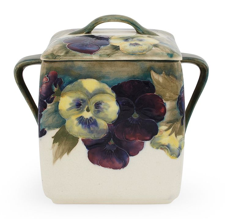 MOORCROFT POTTERY  'PANSIES' BISCUIT BARREL AND COVER, CIRCA 1920  decorated with pansies on a white ground 17cm high