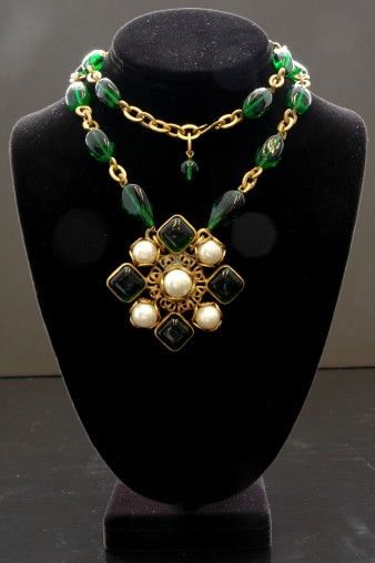 VINTAGE CHANEL GREEN GRIPOIX PEARL NECKLACE WITH GRIPOIX AND PERL PENDANT  Designer: CHANEL    This exclusive piece of vintage jewelry features green gripoix and pearls set in delicate filigree gold tone metal. The links are beautifully twisted making for a superior example of Chanel's workmanship. Circa 1970's.    Price: (USD) $5200.00