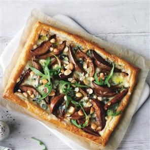 Blue cheese, pear and rocket puff pastry tart recipe. This quick and easy tart recipe is made with Dolcelatte cheese and chopped macadamia nuts.