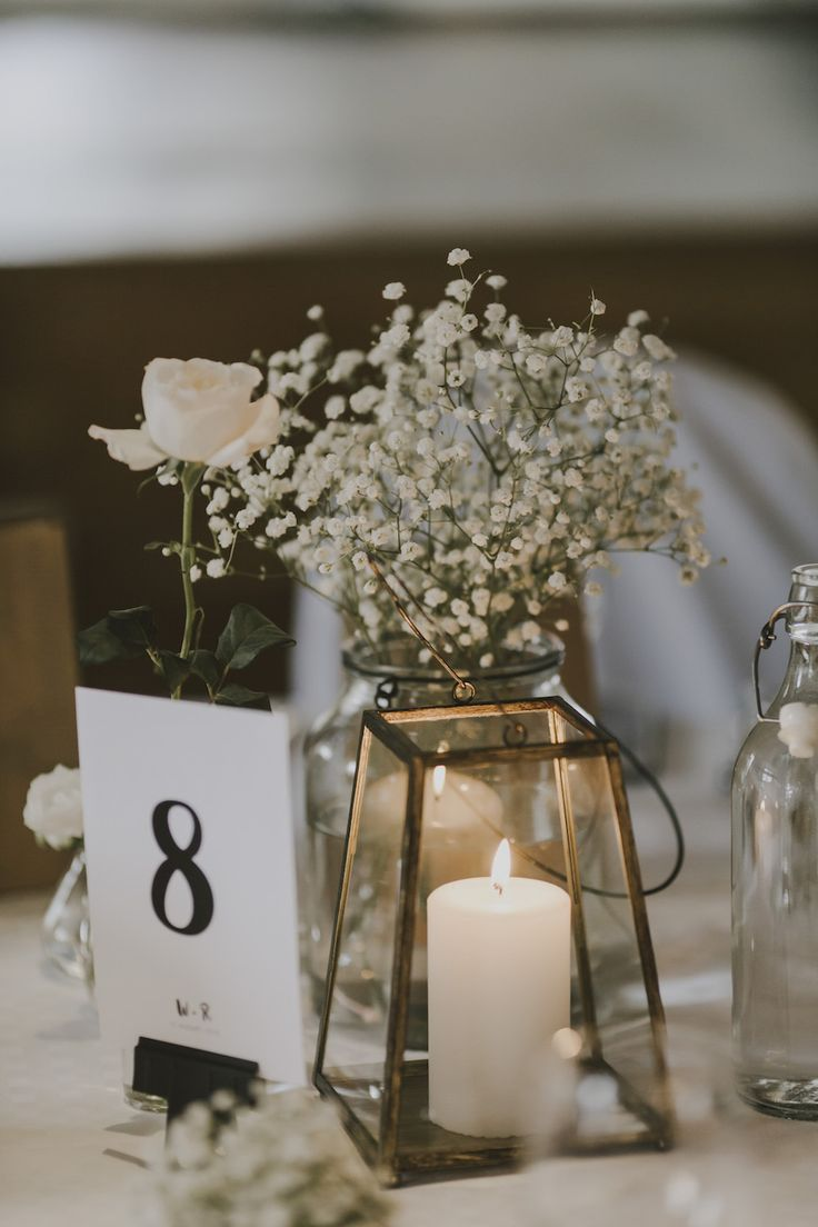 Table Centrepiece with Gypsophila in a Bottle - Matilda Söderström Photography | Barkenbom Creative Film | By Malina Bridal Wedding Dress | White on White Swedish Destination Wedding | Baby Pink ASOS Bridesmaid Dresses