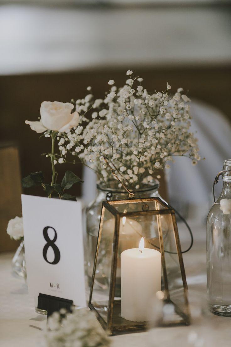 Table Centrepiece with Gypsophila in a Bottle - Matilda Söderström Photography | Barkenbom Creative Film | By Malina Bridal Wedding Dress | White on White Swedish Destination Wedding | Baby Pink ASOS Bridesmaid Dresses