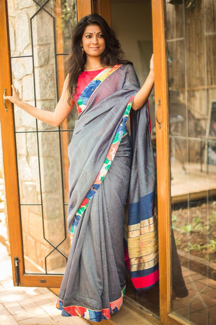 blue cotton drape with fine white lines which looks almost like a trendy denim saree, but with the bonus of cuddly  - Floral border