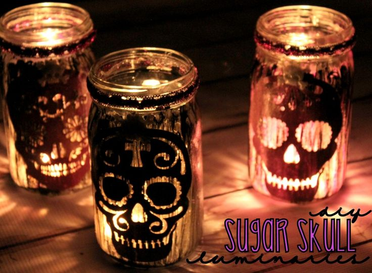 DIY Sugar Skull Luminaries - could do with clear jars and lids, battery lights, and skull stickers