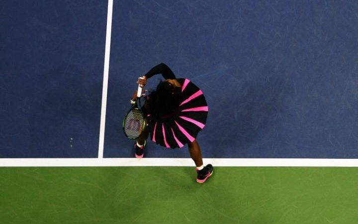 Serena Williams of the US hits a return against Vania King of the US during…