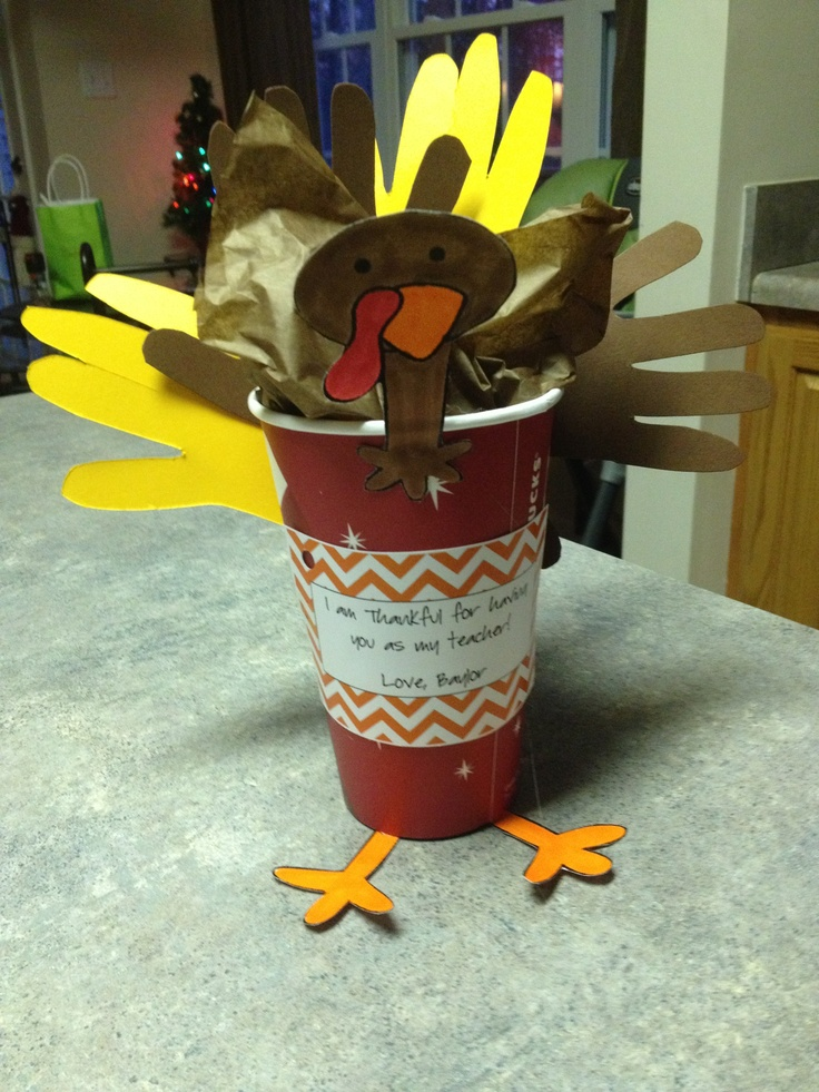 Thanksgiving teacher's gift using A Starbucks cup and holding a Starbucks gift card.