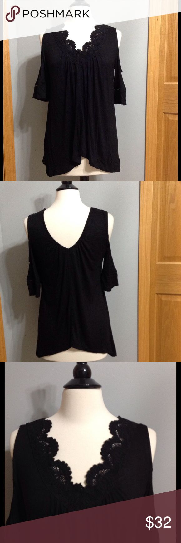 🎉🎉Gorgeous Black Cold-Shoulder Top NWT Lace Trimmed V-Neck Top. High-Low Hem. Gathered Neckline. This Top sold out online and in store in just a few days. I was desperate to get it and I got it online, but it doesn't fit. Grrrr! Stretchy fabric, 95% Rayon 5% Spandex. Maurices Tops Blouses
