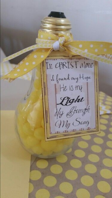 """Lds baptism gift for adult converts. Lightbulb from hobby lobby. Lyrics attached with ribbons: """"in christ alone i found my hope he is my light my strength my song. Filled with lemonheads."""