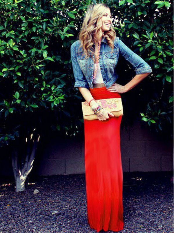Denim jacket, white crop top, and a red maxi skirt.