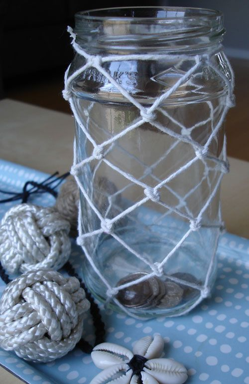 Turn an ordinary glass jar into a nautical coin jar by decorating with DIY fishing net
