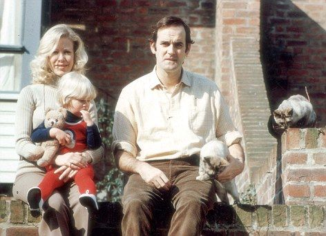 John Cleese, Connie Booth, and the child is likely their daughter.