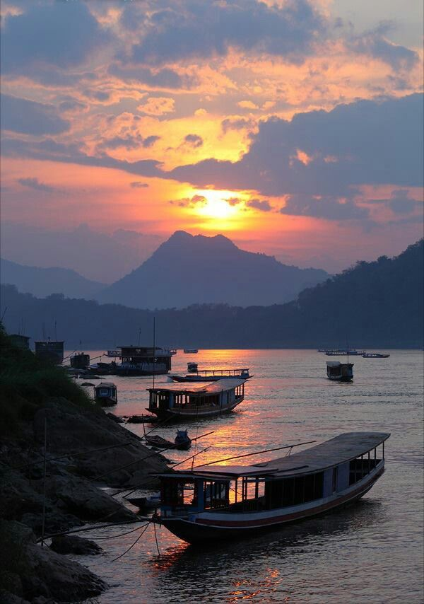 #Luang Prabang #Laos - tourist boats moored on the Mekong River.