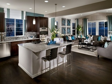 This sleek contemporary kitchen and great room makes a great place to entertain. The Perspectives Series. New homes by Ryland Homes, near Denver.