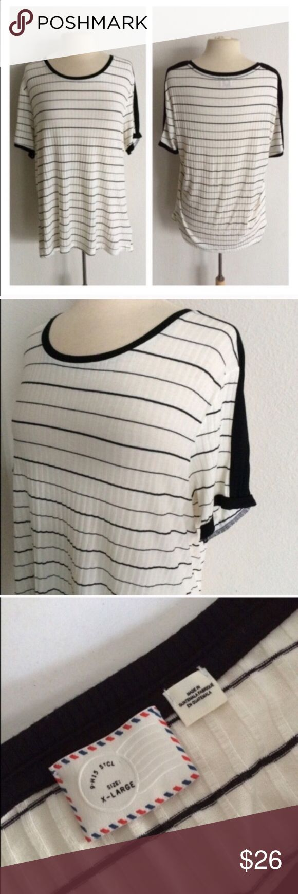 """Postmark striped top Postmark black and white top. Size XL. Measures 29"""" long with a 42"""" bust. 90% rayon/ 6% polyester/ 4% spandex. Extremely soft with great stretch! Very great used condition.  🚫NO TRADES🚫 💲Reasonable offers accepted💲 💰Ask about bundle discounts💰 Anthropologie Tops Tees - Short Sleeve"""
