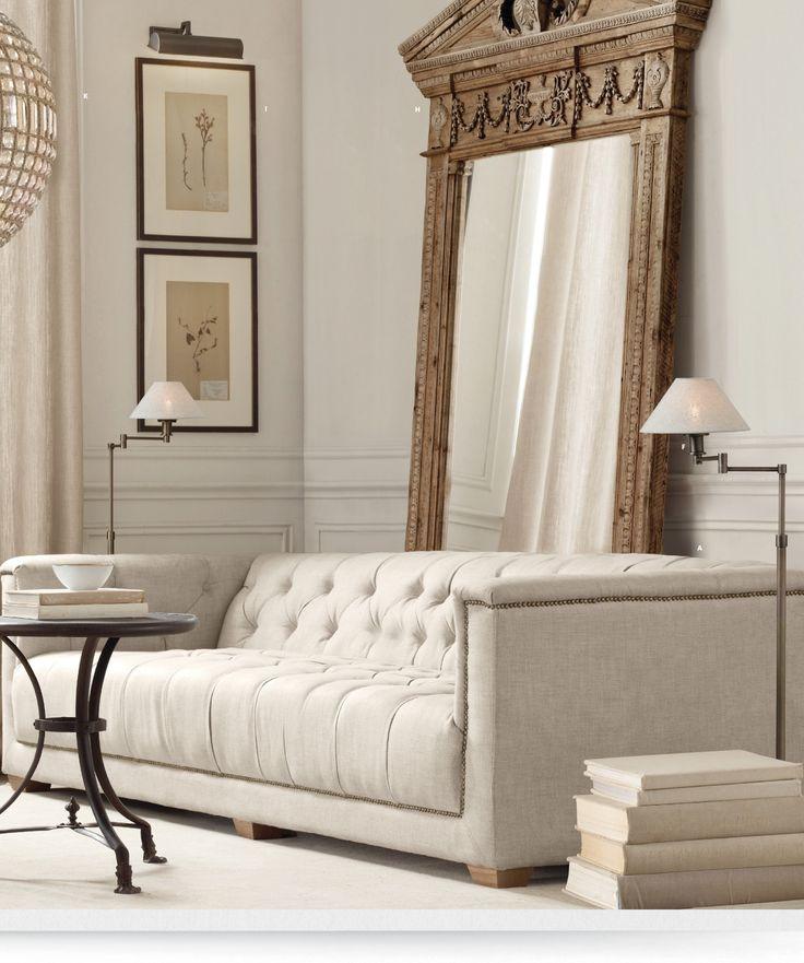 Interior, antique mirror on floor, modern sofa via Restoration Hardware