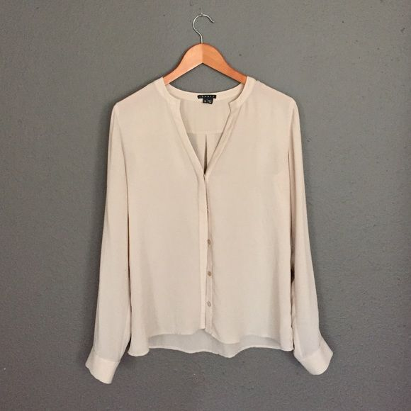 Theory | Beige Blouse 100% polyester. Beige. Slight shear. Buttons run down the front. Like new condition. Classic staple to your business casual wardrobe. Theory Tops Blouses