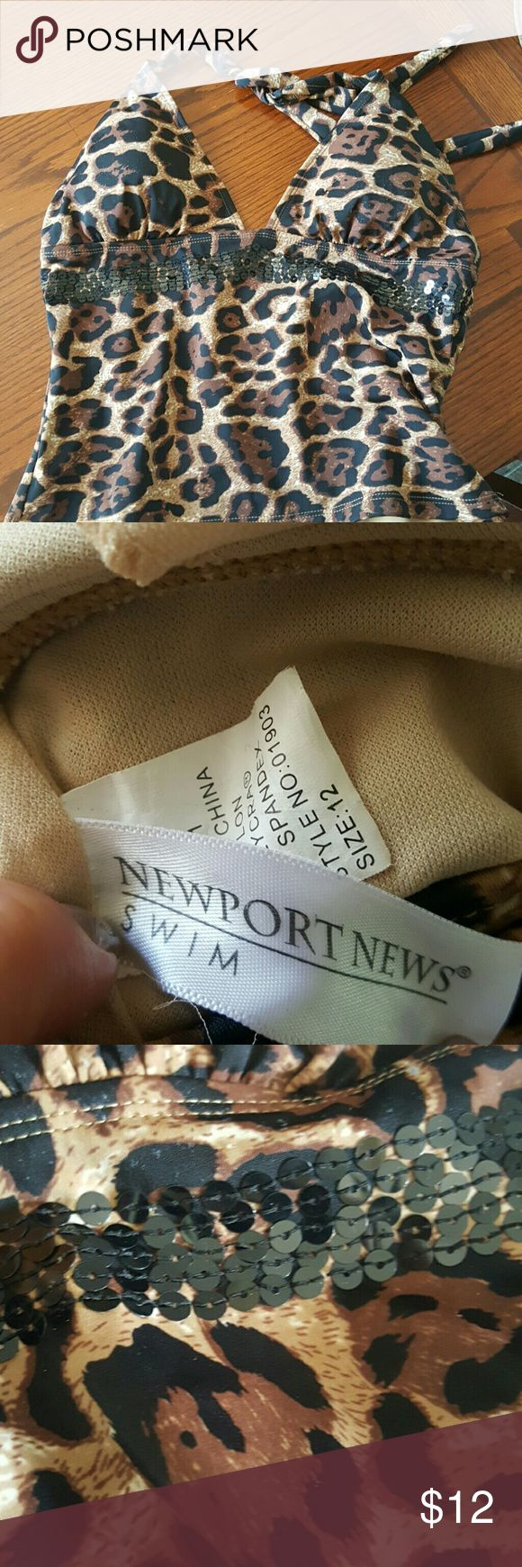Tankini top Newport News leopard print tankini top very good quality.  I wore them with basic black bottoms Newport News Swim