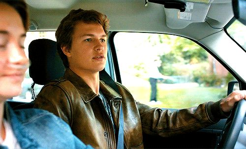 Augustus Waters and his adorable face, while Hazel Grace is serenely enduring