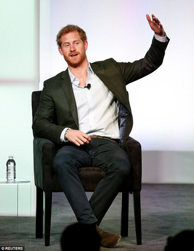 Prince Harry opted for a business casual look, sporting a blazer, trousers, and a button-down shirt that he left open at the collar