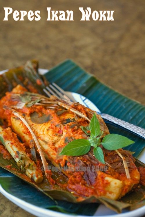 Manado woku spiced fish wrapped in banana leaves - Indonesian food -