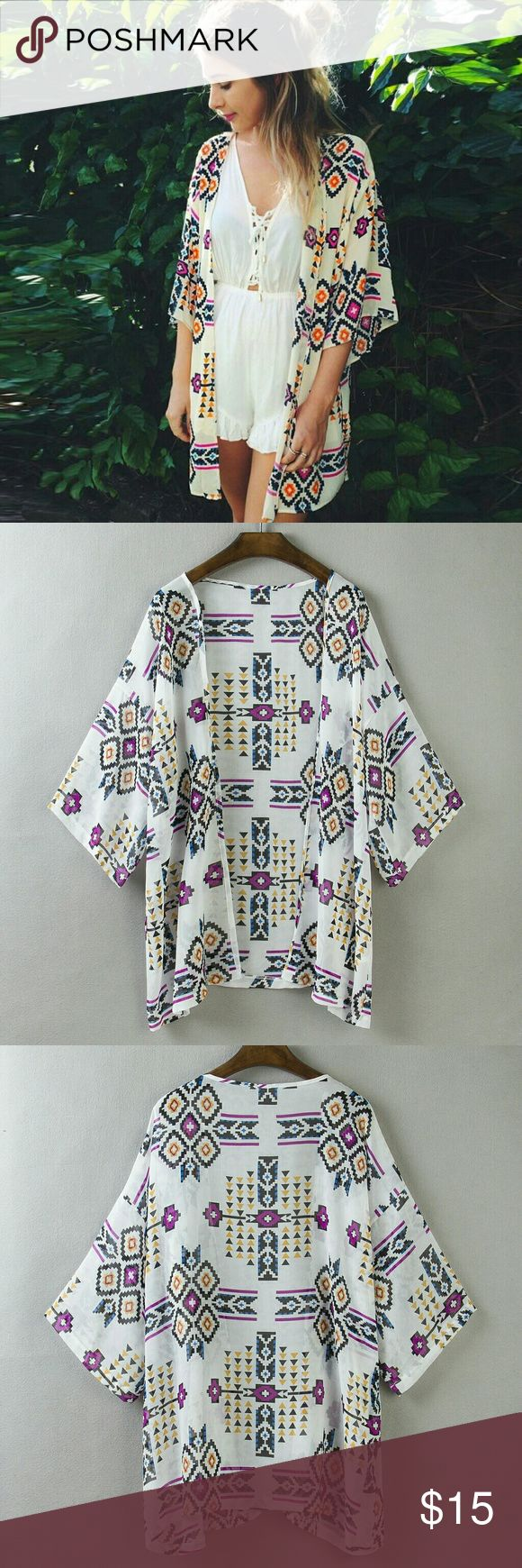 Kimono Cardigan Multiple color print, white with black purple, yellow, and blue designs. Batwing sleeve kimono. See size chart in pictures above for accurate ordering.  Material: Polyester Swim Coverups