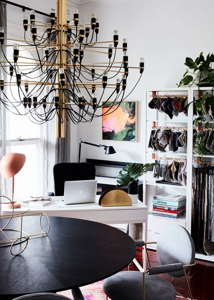 A feature chandelier makes this home office an inspiring place to work, while a table from Globe West is the practical solution to at-home business meetings.