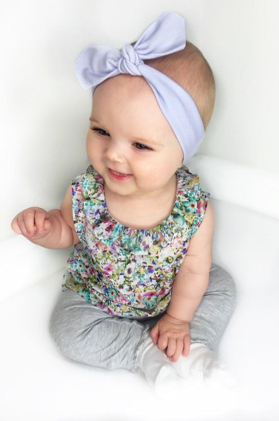 Our outfit of the day today is this supercute floral sleevles blouse by Next Kids and some Grey Marl leggings by Baby Gap. We chose our Lavender Baby Headband to complement the pretty floral print, but we could have also paired this top with any of our pastel solid shades.
