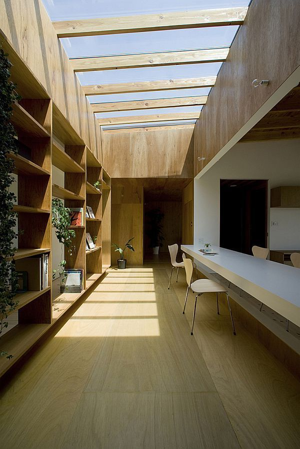"A simple and modern Japanese house by Studio Synapse. This room has wabi elements, as it is simple, uses natural materials, and was obviously constructed by hand (built in shelves, table, paneling). It may not be sabi since it is a new construction, however the design is very classic. This could be a ""modern"" California home from the late 40s."