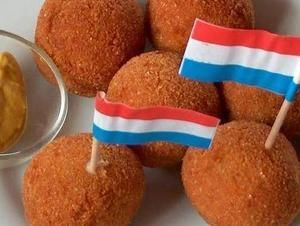Bitterballen are deep-fried snacks that are ubiquitous in cafes and bars all over the Netherlands. These savory orbs are battered in a crunchy breadcrumb coating and filled with a gooey mixture of chopped beef, beef broth, flour, butter, herbs and spices. They are typically served with mustard for dipping.