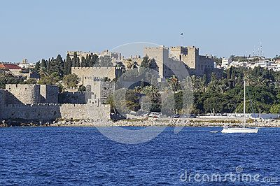 View on the  Rhodes Town with  harbor and old building of castle and coast , Greece.