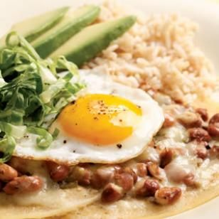 "Huevos rancheros or ""ranch eggs"" is a classic Mexican dish that is great for a quick dinner. Traditionally, its made with a red tomato-based sauce. Here we use tart and tangy green salsa instead. Serve with: brown rice and slices of avocado."