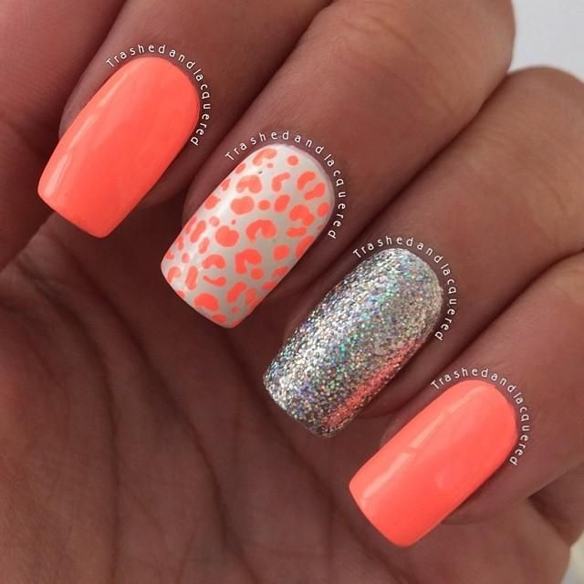 Neon coral manicure with amazing accent nails. One sports a cheetah print made with the neon coral polish. The other is completely painted with a silver glitter polish.
