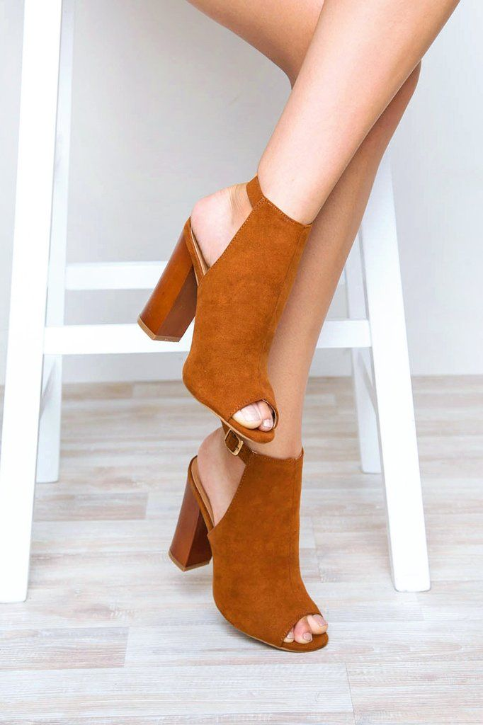 """It'll be good for ya! Our chestnutBack For Good Heels feature a faux suede material, open-toe styling and open back with adjustable ankle strap. Stacked block heel. Gold hardware. Cushioned insole and rubber bottom sole with non-skid markings.*Man Made Materials*Shoe Height: 8""""*Heel Height: 4.5""""*Imported"""