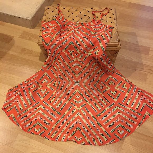 Orange spring dress size XS Brand new with tag. Cute design in the back, great for spring flings!  Fire Los Angeles Dresses Mini