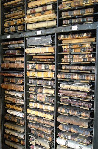 Shelves full of old books and ledgers