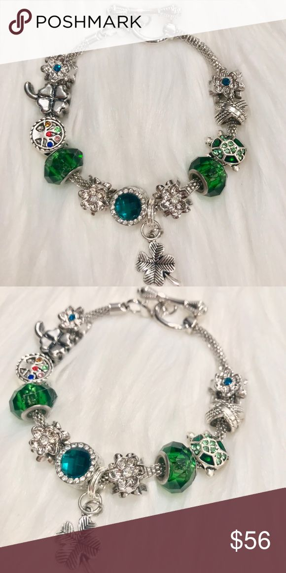 Feeling Lucky Charm Bracelet🍀 ♧ 1 sterling silver antiques 4 Leaf clover charm  ♧ 1  sterling silver & green crystal turtle floating charm bracelet  ♧1 Tree of Life Charm that is decorated with multi colored rhinestones and it is engraved with Family and Love around the sides ♧ 2 royal green murano glass beads  ♧ 4 blooming flower spacer charms with crystal center ♧2 royal green crystal charms framed with crystal stones and has heart cut outs Designed on a silver toggle bracelet- **also…