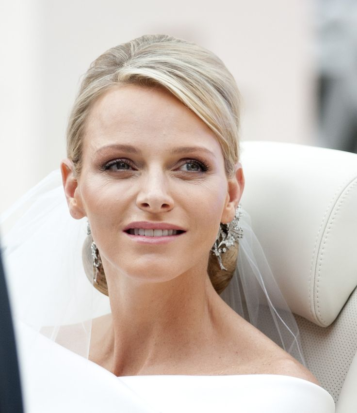 Princess Charlene, still with tears in her eyes, leaves the Royal Palace with her Prince after the wedding.