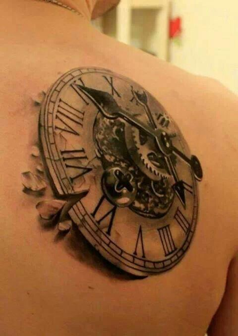 Clock tattoo..a bit bigger than I want, but the detail is exquisite! Looks as if it is rising out of his shoulder.