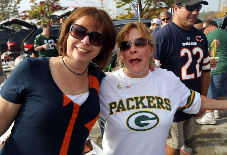 Lisa Johnson, left, of Bartlett and Sue Haas of Roselle are friends for now as they tailgate prior to the Bears Packers game Sunday at Soldier Field in Chicago.