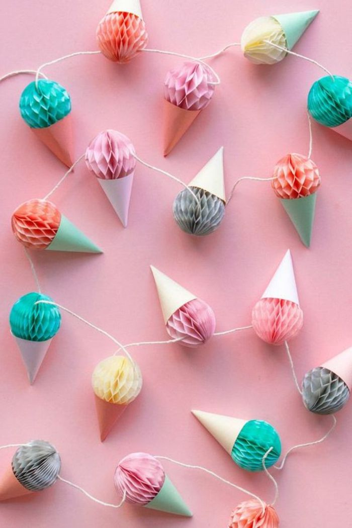 easy fun diys, long garland made from paper ice cream cone ornaments, in yellow and pink, red and turquoise, grey and other colors, tied together with string