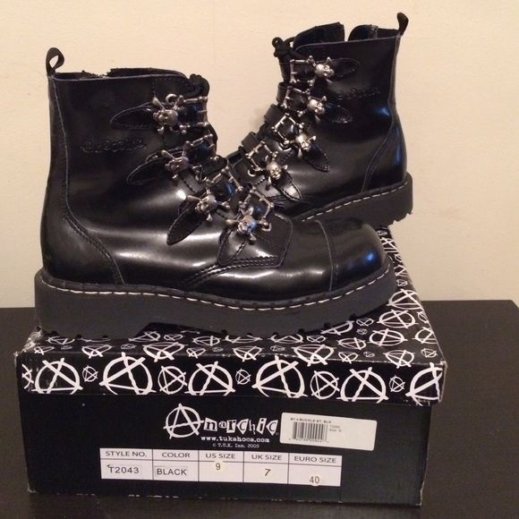 Anarchic skull buckle boots New Anarchic (TUK) boots with cool skull buckles. Laces and zippers on the inside. The come just over the ankle. Very comfortable (this is my third pair!) Leather/action leather (just reading the tag), rubber soles. Tuk Shoes Combat & Moto Boots