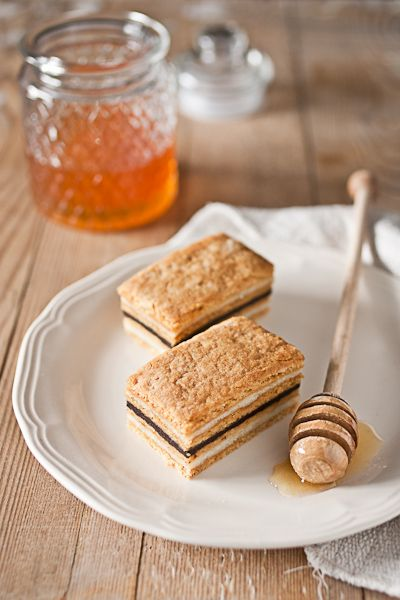 Honey Cake, a Croatian dessert with thin layers of honey biscuit sandwiching vanilla and cream fillings.