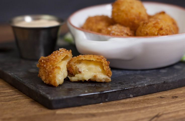 Potatoes, Gouda cheese and sauerkraut are rolled into balls and fried to perfection for an authentic homemade take on this Irish pub appetizer.