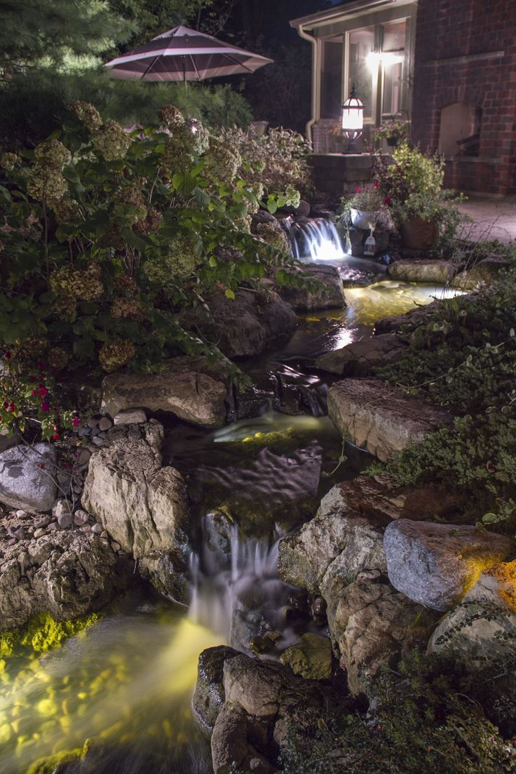 Backyard Waterfall Lit At Night With Led Pond And Landscape