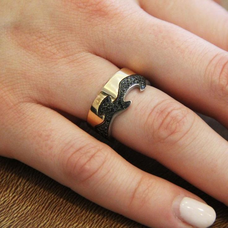 Georg Jensen rose gold and black spinel Fusion rings that slot perfectly together like a puzzle. Worn on a model's hand. http://www.thejewelleryeditor.com/jewellery/article/georg-jensen-fusion-ring-competition/ #jewelry
