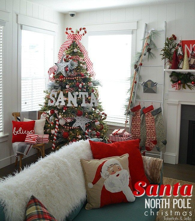 Santa North Pole Christmas Tree decorating ideas. Make a simple red and white Santa christmas tree. Find all the details and DIY ideas at Tatertots and Jello! MichaelsMakers