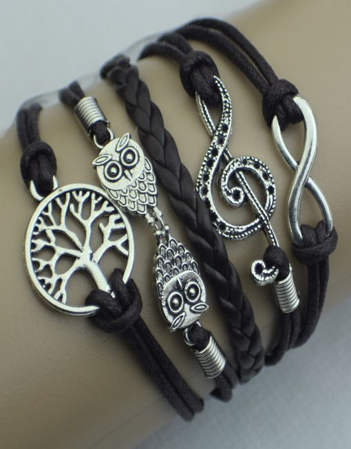 "Our popular leather wrap bracelets - this one features the infinity symbol, a G-clef music note, two owls, and a tree. Dark brown with silver.  Bracelet is 6 inches long with a 2 inch extender.  If this ModWrap notes ""Available on backorder"", you will receive it in 1-2 weeks."